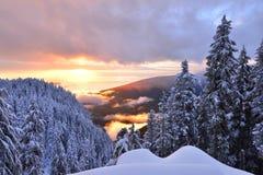 Puesta del sol en la montaña del urogallo Fotos de archivo libres de regalías