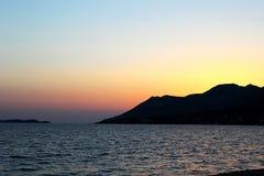 Puesta del sol en la península Foto de archivo