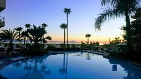 Puesta del sol en la piscina Fotografía de archivo libre de regalías