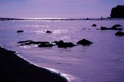 Puesta del sol en la playa imagen de archivo