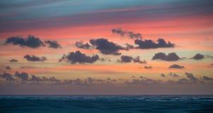 Puesta del sol en la playa Fotografía de archivo libre de regalías