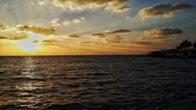 Puesta del sol en la playa de Alex Fotos de archivo