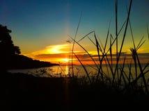 Puesta del sol en la playa de Bangkah Foto de archivo libre de regalías