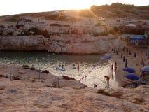 Puesta del sol en la playa de Cala Francese Fotografía de archivo libre de regalías