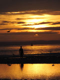 Puesta del sol en la playa de Crosby Fotografía de archivo