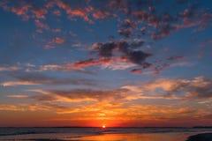 Puesta del sol en la playa de la locura Imagen de archivo