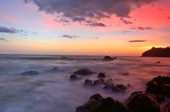 Puesta del sol en la playa de Muir Imagen de archivo libre de regalías