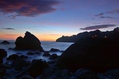 Puesta del sol en la playa de Muir Foto de archivo libre de regalías