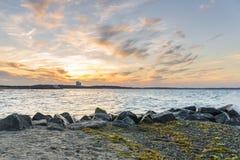 Puesta del sol en la playa de Niendorf en luebeck Imágenes de archivo libres de regalías