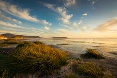 Puesta del sol en la playa de Noordhoek fotos de archivo libres de regalías