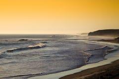 Puesta del sol en la playa de Strandfontein Imagenes de archivo
