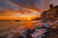 Puesta del sol en la playa de Therma foto de archivo