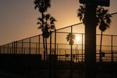 Puesta del sol en la playa de Venecia sobre cortes del deporte imagen de archivo libre de regalías