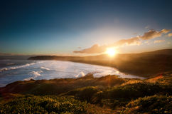 Puesta del sol en la playa del St Clair Imagen de archivo