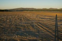Puesta del sol en la playa muy ancha un Harlech, País de Gales Imagenes de archivo