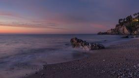 Puesta del sol en la playa temprano fotografía de archivo libre de regalías