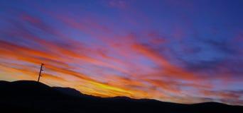 Puesta del sol en las colinas Fotografía de archivo libre de regalías