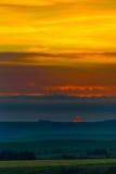Puesta del sol en las colinas Fotografía de archivo
