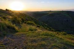 Puesta del sol en las colinas Imagen de archivo libre de regalías