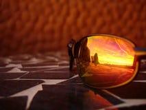 Puesta del sol en las gafas de sol Fotos de archivo libres de regalías