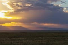 Puesta del sol en las grandes dunas de arena Imagenes de archivo