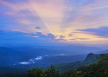 Puesta del sol en las montañas Imágenes de archivo libres de regalías