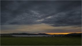 Puesta del sol en Loch Lomond - Escocia Imágenes de archivo libres de regalías