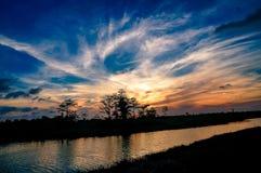 puesta del sol en los pantanos foto de archivo libre de regalías