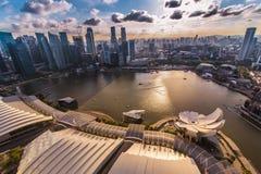 Puesta del sol en Marina Bay, Singapur imágenes de archivo libres de regalías