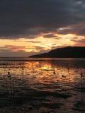 Puesta del sol en mojones Imagen de archivo