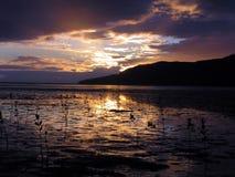 Puesta del sol en mojones Imagenes de archivo
