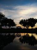Puesta del sol en parque Imagenes de archivo