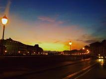 Puesta del sol en Pisa Imagen de archivo