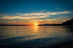 Puesta del sol en playa croata Imagen de archivo libre de regalías