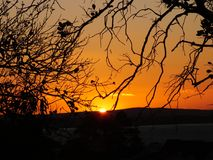 Puesta del sol en Porto Alegre, el Brasil imagen de archivo