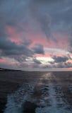 Puesta del sol en rastro del barco Imagen de archivo libre de regalías