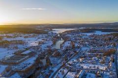 Puesta del sol en Smedjebacken en invierno foto de archivo libre de regalías