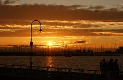 Puesta del sol en St Kilda Imagen de archivo libre de regalías