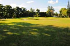 Puesta del sol en un campo de golf Imagen de archivo libre de regalías