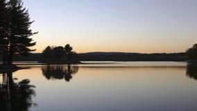 Puesta del sol en un lago Imagenes de archivo
