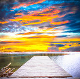 Puesta del sol en un lago Foto de archivo libre de regalías