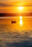 Puesta del sol en un lago Imagen de archivo libre de regalías