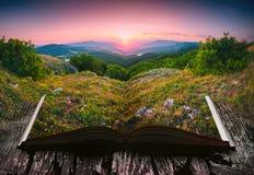 Puesta del sol en un valle en las páginas de un libro abierto Fotografía de archivo libre de regalías