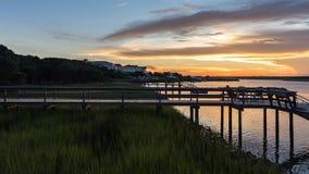 Puesta del sol en una entrada de la costa este imagenes de archivo