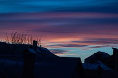 Puesta del sol en una tarde del invierno Fotos de archivo libres de regalías