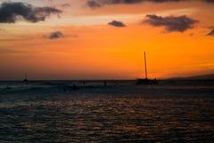 Puesta del sol en Waikiki Foto de archivo libre de regalías