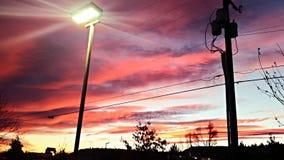 Puesta del sol encendida parque Imagenes de archivo