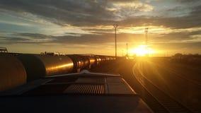 Puesta del sol ferroviaria Imagen de archivo libre de regalías