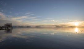 Puesta del sol hermosa del lago Fotografía de archivo