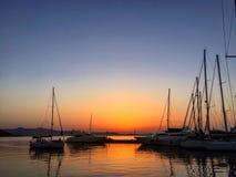 Puesta del sol hermosa en el puerto Fotos de archivo libres de regalías